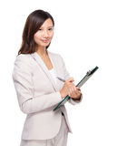 Business woman take note on clipboard Stock Images