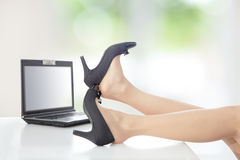 Business woman take off her high heels shoes Royalty Free Stock Photos