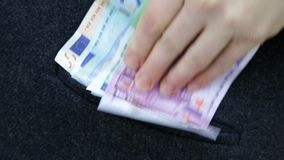 Business woman takes big amount euros and putting in pocket after good deal successful money stays visible stock video