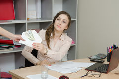 Business woman takes a bribe in an envelope Royalty Free Stock Images
