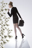 Business Woman Taking A Dollar From Money Plant Stock Image