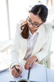 Business woman taking down notes Stock Images