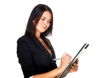 Business woman taking notes Stock Photo