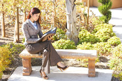 Business woman taking notes Royalty Free Stock Photos