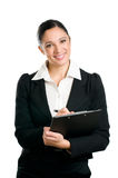 Business woman taking notes on clipboard Stock Photography