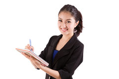 Business woman taking notes Stock Image