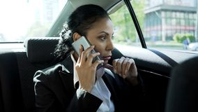 Business woman taking on phone in car, stressful life of lady boss, career. Stock photo royalty free stock photography