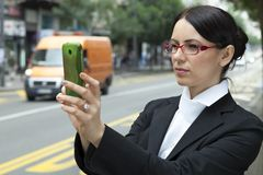 Business woman taking a picture Royalty Free Stock Photo