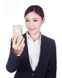 Business woman taking selfie photo with smartphone isolated on w Stock Image