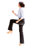 Business woman taking a step forward Stock Image