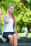 Business woman talking on a cell phone Royalty Free Stock Photos