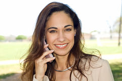 Business woman talking on cell phone Stock Photos