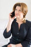 Business woman talking on cell phone. Business woman talking on a cell phone Royalty Free Stock Images
