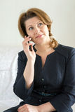 Business woman talking on cell phone. Business woman talking on a cell phone Stock Photography