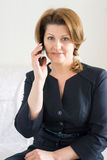 Business woman talking on cell phone. Business woman talking on a cell phone Royalty Free Stock Photography