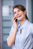 Business woman talking on cell phone Royalty Free Stock Images
