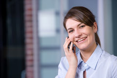 Business woman talking on cell phone Stock Images