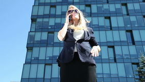 Business woman  talking on cell phone stock video footage