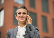 Business woman talking cell phone. Happy business woman talking cell phone in front of office building Stock Photos