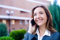 Business woman talking cell phone Royalty Free Stock Images
