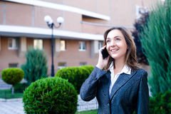 Business woman talking cell phone Stock Photo