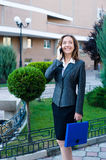 Business woman talking cell phone Royalty Free Stock Image