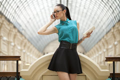 Business woman talking on cell phone. Young beautiful woman talking on cell phone Royalty Free Stock Photos