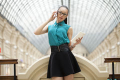 Business woman talking on cell phone. Young beautiful woman talking on cell phone Royalty Free Stock Photography