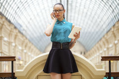Business woman talking on cell phone. Young beautiful woman talking on cell phone Royalty Free Stock Images