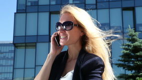 Business woman talking on cellular phone stock footage