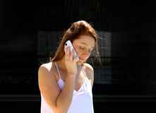 Business woman talking on her mobile phone Royalty Free Stock Photo