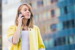Business woman talking on her mobile smart phone Stock Photo