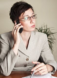 Business woman talking on mobile Royalty Free Stock Photos