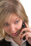 Business woman talking on mobile phone. Head portrait of an attractive business woman talking on a cellular phone (GSM Royalty Free Stock Photography