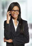 Business woman talking with mobile phone Stock Image