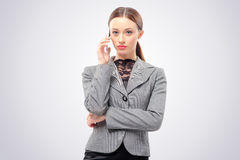 Business woman talking on the mobile phone Royalty Free Stock Photography