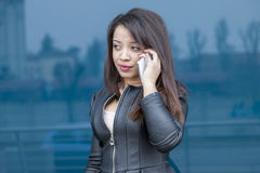 Business woman talking on mobile smart phone Royalty Free Stock Photography