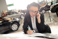 Business woman talking by phone Royalty Free Stock Photos