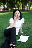 Business Woman talking on phone. Business Woman talking on the phone in the park Royalty Free Stock Images