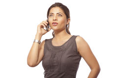 Business Woman Talking on Phone. Portrait of business woman talking on phone over white background stock images