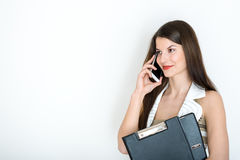 Business woman talking on phone against a white background Royalty Free Stock Photography