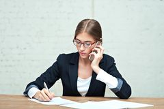 Business woman talking on phone royalty free stock images