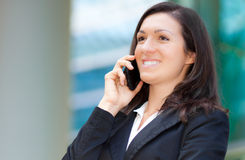 Business woman talking at the phone Royalty Free Stock Photo