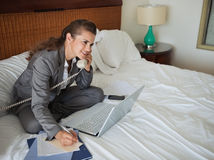 Business woman talking phone in hotel room Royalty Free Stock Photo