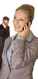 Business woman talking on the phone with man Royalty Free Stock Image