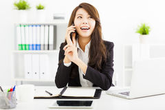 business woman talking on the phone in office Royalty Free Stock Images