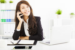 Business woman talking on the phone in office Stock Image