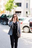 Business woman talking on the phone outdoors royalty free stock images