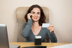 Business woman talking at phone Stock Image