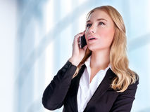Business woman talking on phone Stock Photo